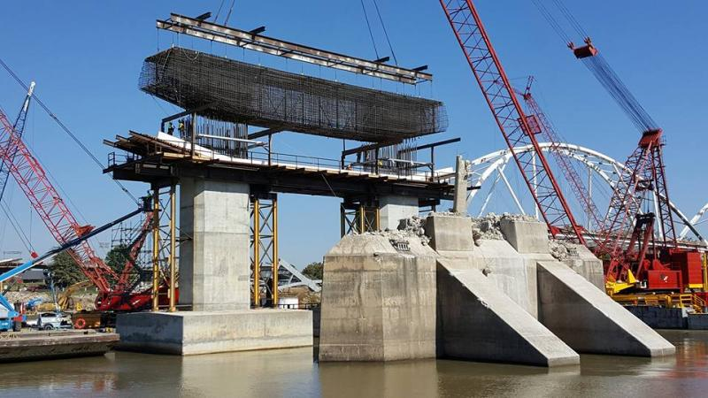 Little Rock's Broadway Bridge simultaneously being destroyed and reconstructed